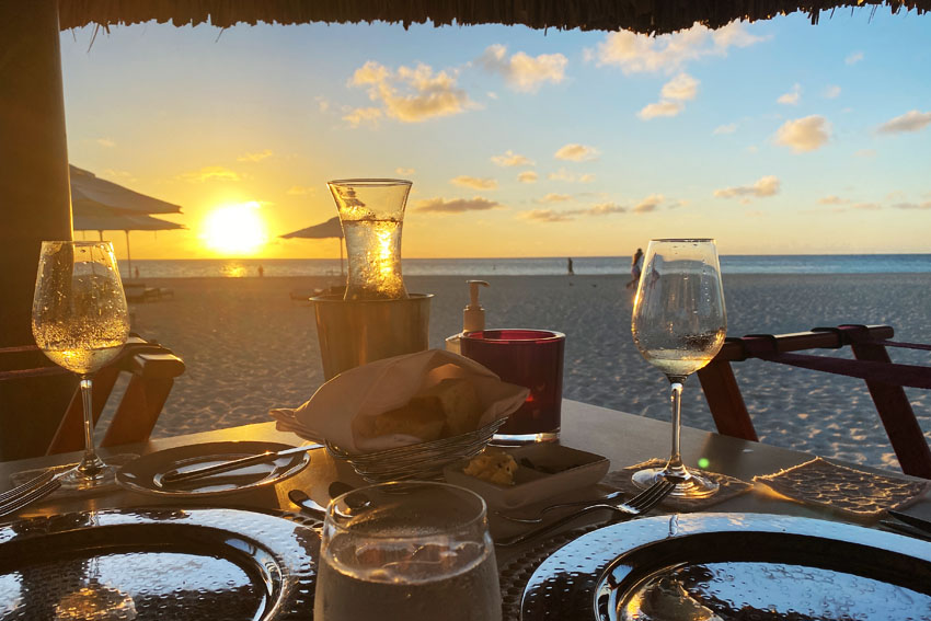 Enjoy one of the best sunsets at the island at Elements Restaurant